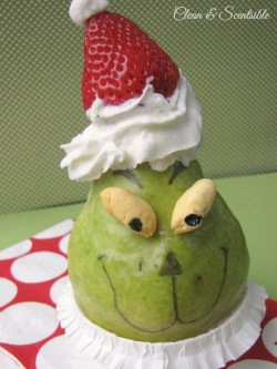 Pear Grinch! Make a Grinch out of a pear, nuts, strawberries and whipped cream!